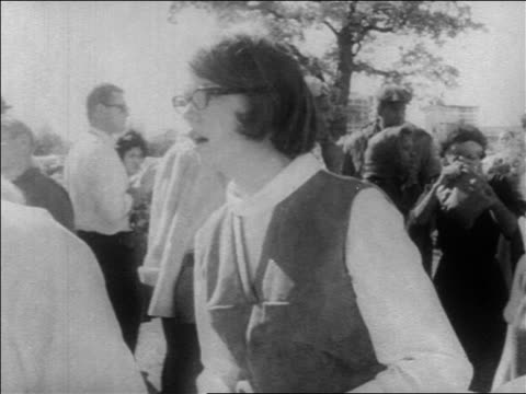 b/w 1963 woman learning of jkf's death putting hand on mouth crying outdoors / newsreel - attentat auf john f. kennedy stock-videos und b-roll-filmmaterial