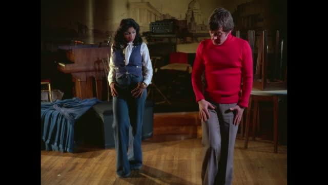 vídeos de stock, filmes e b-roll de 1976 - woman learns to striptease dance - stripper