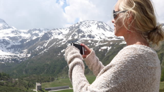 woman leaves car at mountain viewpoint, takes pic - see other clips from this shoot 56 stock videos & royalty-free footage
