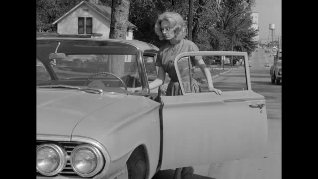 1962 a woman leaves her apartment for good - moving down stock videos & royalty-free footage