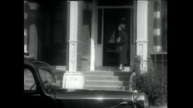 woman leaves house, puts milk bottles on doorstep; 1955 - 1955 stock videos & royalty-free footage