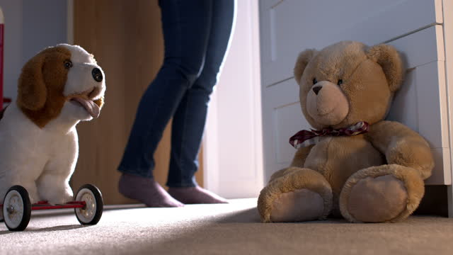 woman leaving a child's bedroom. low angle shot with toys on the floor. - teddy bear stock videos & royalty-free footage