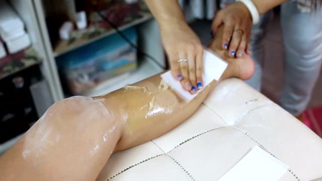 woman leg waxing beauty