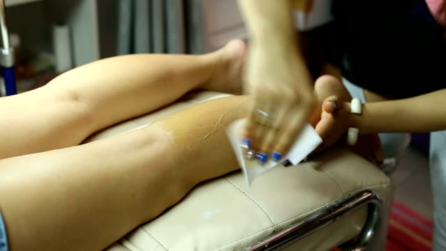 woman leg waxing beauty - human leg stock videos and b-roll footage