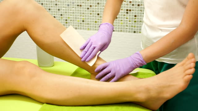 woman leg waxing - beauty salon stock videos and b-roll footage