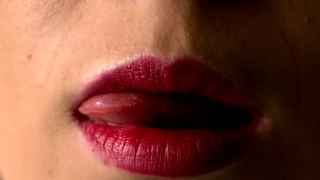 woman licking her red lips - human tongue stock videos & royalty-free footage