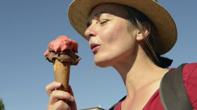 cu woman licking italian ice cream from an ice cream cone / garda, verona, italy - waffle cone stock videos and b-roll footage