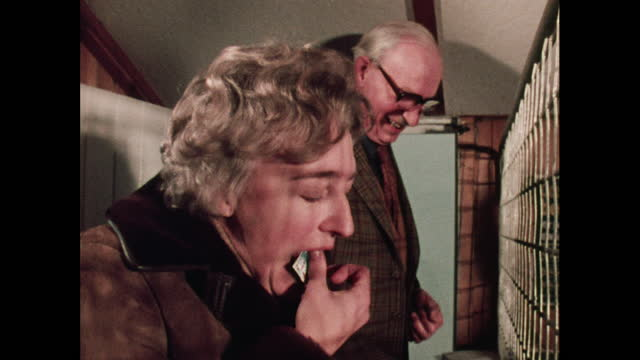 woman licks a stamp in a post office, 1970s - postage stamp stock videos & royalty-free footage