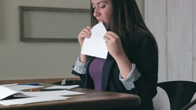 woman licks to seal envelope then writes address on letter - messaggio video stock e b–roll