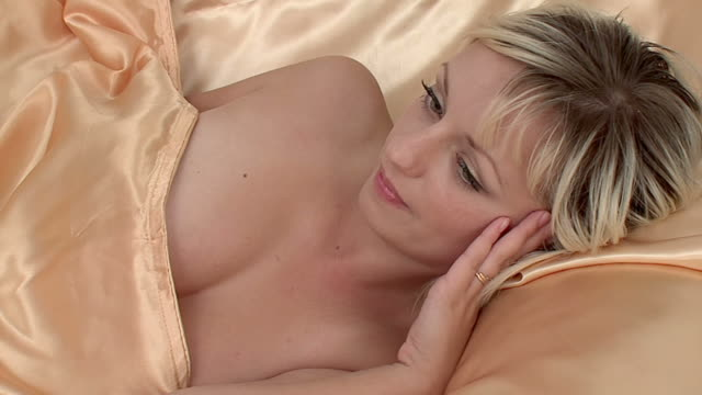 woman lies on a bed - adult stock videos & royalty-free footage