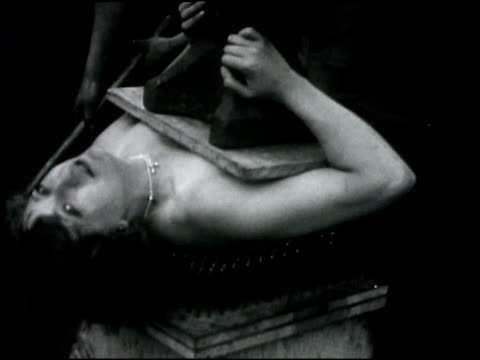 woman lies on bed of nails - lying on back stock videos & royalty-free footage