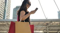 Woman lifestyle with Shopping Bag and Smart phone
