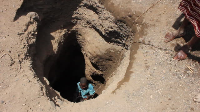 ms zi tu woman lifting bucket near well / todonwang, turkana, kenya - drought stock videos & royalty-free footage