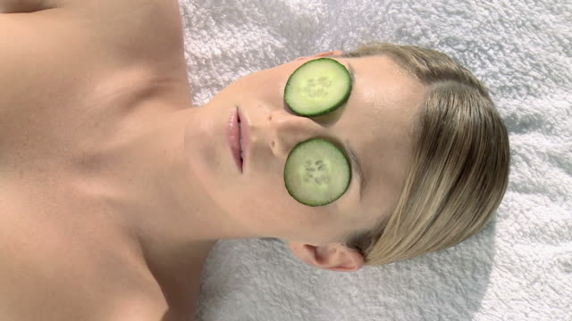 Woman lifting cumber from eyes