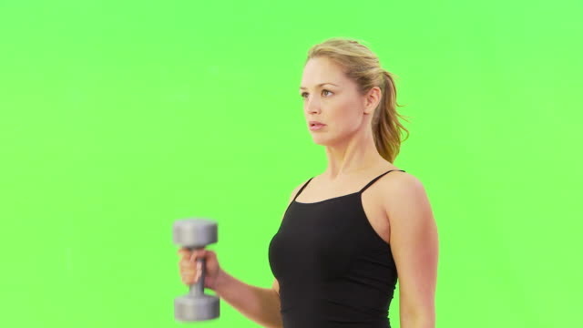woman lifting free weights - arm curl stock videos & royalty-free footage