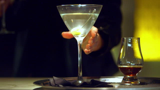 cu woman lifting martini off of tray - martini stock videos & royalty-free footage