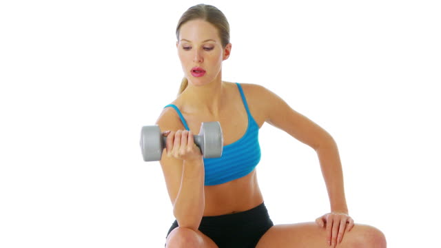 woman lifting weights - arm curl stock videos & royalty-free footage