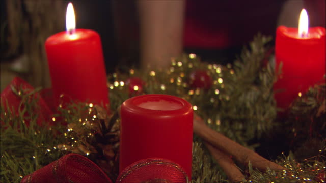 cu woman lighting christmas candles / near salzburg, austria - wreath stock videos & royalty-free footage