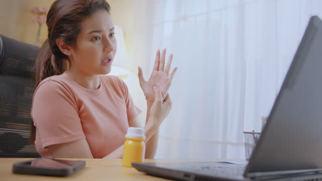 woman listen to doctor via laptop video call virtual care services and stretching from advice at home. - health technology stock videos & royalty-free footage