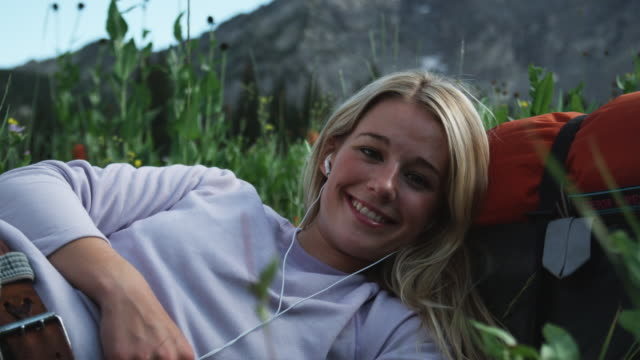 woman listening to music outdoors - alta utah stock videos and b-roll footage