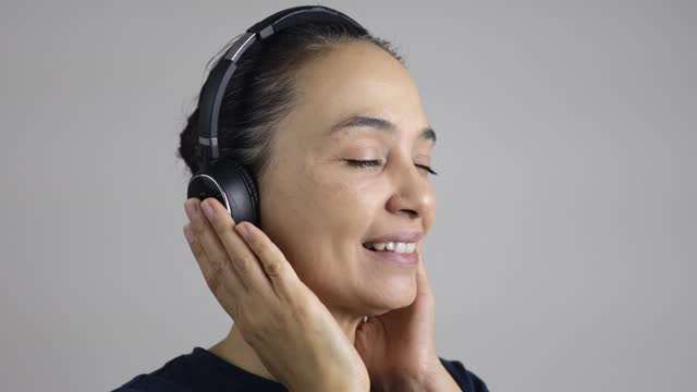 woman listening to music with headphones - eyes closed stock videos & royalty-free footage