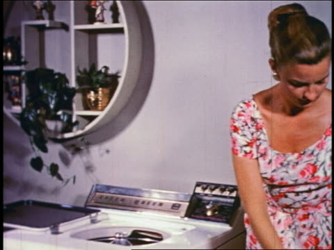 1950 woman loading clothing into + operating washing machine - 10 sekunden oder länger stock-videos und b-roll-filmmaterial