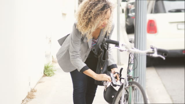 woman locking up bicycle