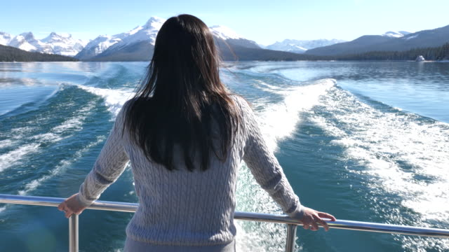 woman looking and enjoying the view at the ship's wake - carefree stock videos & royalty-free footage