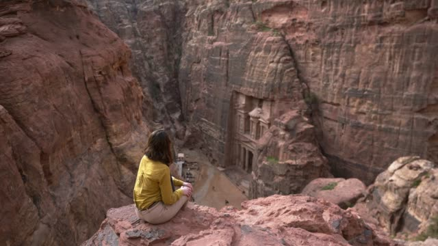 woman looking at al-khazneh in petra - old ruin stock videos & royalty-free footage