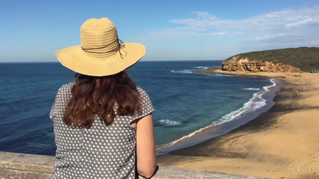 woman looking at bells beach victoria australia - hat stock videos & royalty-free footage