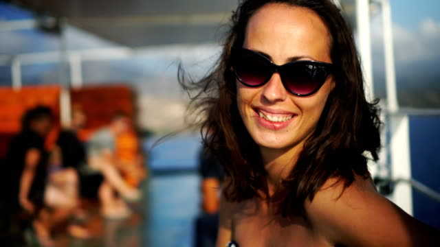 woman looking at camera and smiling - ferry deck stock videos & royalty-free footage