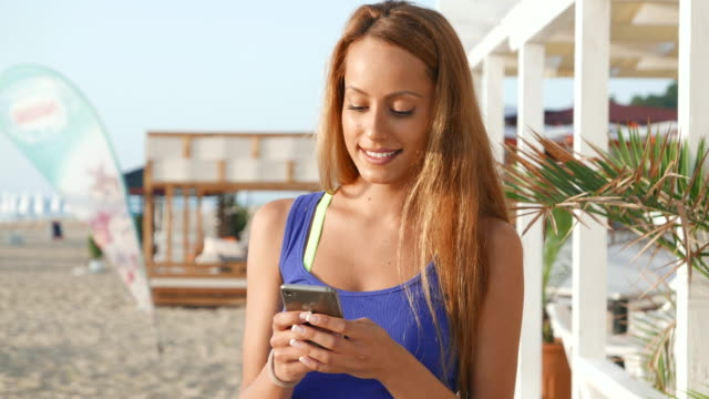 woman looking at camera and texting - girls flashing camera stock videos and b-roll footage