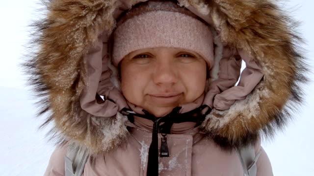 woman looking at camera at winter - ski resort stock videos & royalty-free footage