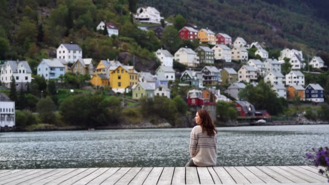 woman looking at cityscape  of odda town in norway - city break stock videos & royalty-free footage