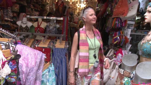 MS PAN Woman looking at clothes at street market, Bangkok, Thailand