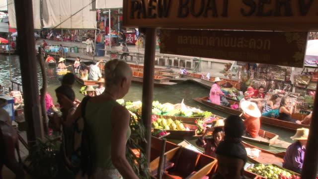 MS PAN Woman looking at Damnoen Saduak floating market, Bangkok, Thailand