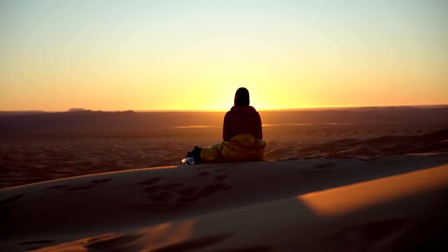 Woman Looking at  desert sunset