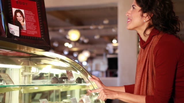 ms tu td woman looking at desserts in display case / sante fe, new mexico, usa - dessert stock videos & royalty-free footage