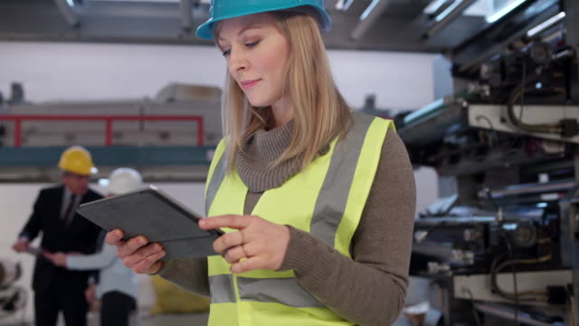 Woman looking at digital tablet