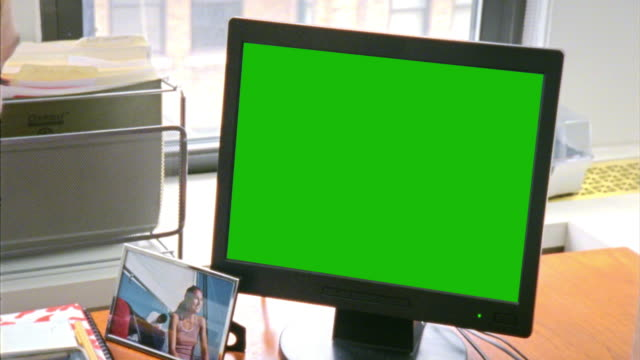 cu woman looking at green computer screen, new york city, new york, usa - over the shoulder view stock videos & royalty-free footage