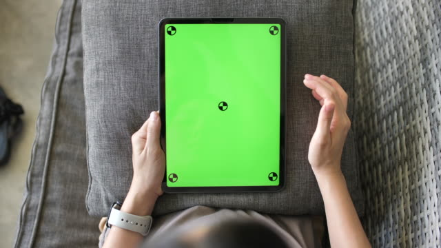 woman looking at green screen digital tablet - green colour stock videos & royalty-free footage