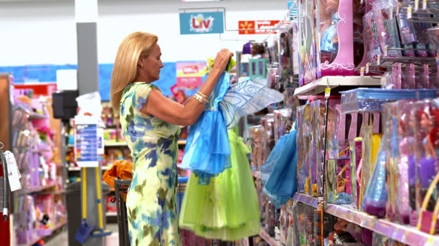 MS PAN  Woman looking  at kids costumes in toy section of big box store  / La Quinta, California, United States
