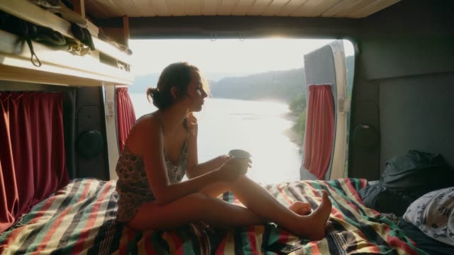 woman looking at lake of sainte croix and drinking tea in camper van - lakeshore stock videos & royalty-free footage