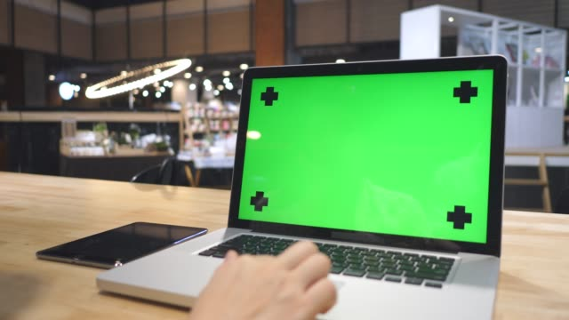 woman looking at laptop with green screen - computer key stock videos and b-roll footage