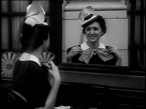 1939 montage woman looking at mirror in optical illusion / alabama, united states - optical illusion stock videos & royalty-free footage