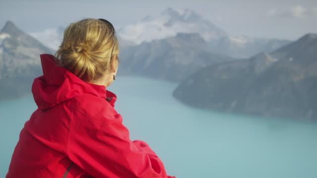ms pan woman looking at mountain landscape, garibaldi provincial park, squamish, british columbia, canada - garibaldi park stock videos & royalty-free footage