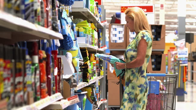 MS Woman looking  at products in household supply section of big box store  / La Quinta, California, United States