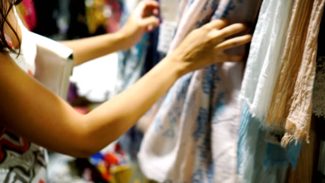 woman looking at scarf in clothing store - square stock videos & royalty-free footage