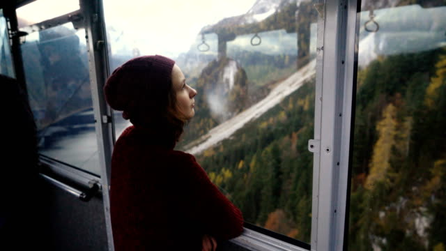 woman looking at scenic view of  lake in alps from cable car - austrian culture stock videos & royalty-free footage