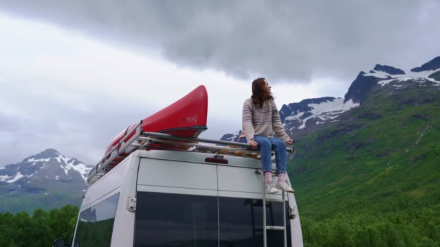 woman looking at  scenics on lofoten islands from camper van - van stock videos & royalty-free footage